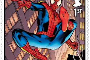 a close up of a window: Spiderman is one of ten superheroes to feature of the set of stamps
